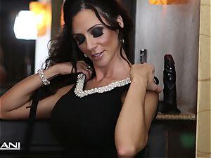 Ariella Ferrara tucks a huge black dildo in her muff
