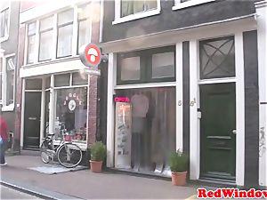 Amsterdam prostitute fellates client