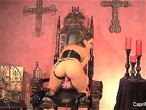dark-haired bombshell Capri wanks on her throne