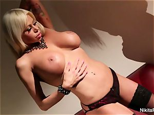 sizzling cougar Nikita Von James taunts and fingers her honeypot
