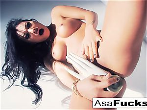 Asa Akira uses a faux hand to sate her pussy