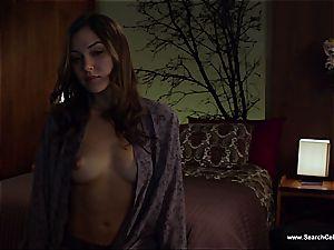 beautiful Sasha Grey bares her smallish breasts