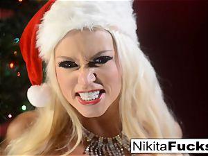 Nikita Von James celebrates Christmas with her puss