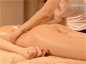 Elena being lubricant kneaded by another lady