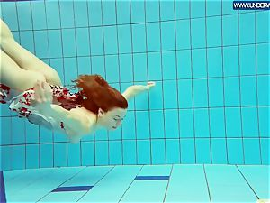 scorching polish ginger-haired swimming in the pool